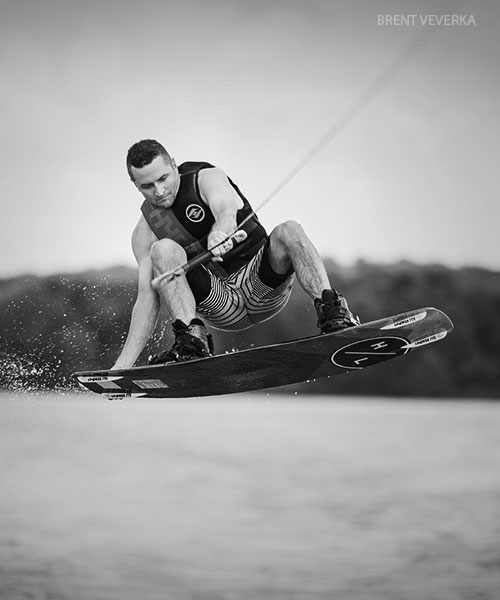 wakeboards available at sun valley sports - man jumping on wakeboard